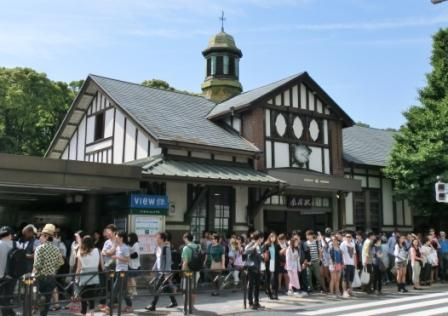 The cozy station of Harajuku. The woods behind the station are Meiji-Jingu Shrine